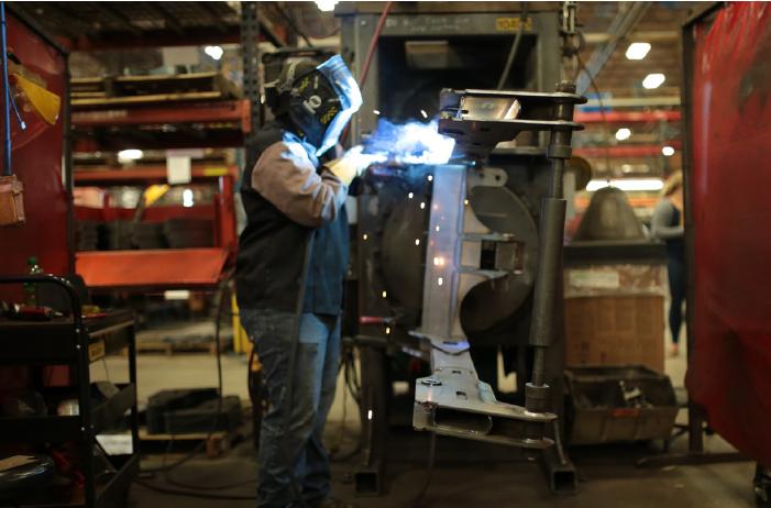 A photo of a Steffes welder welding a piece of metal equipment